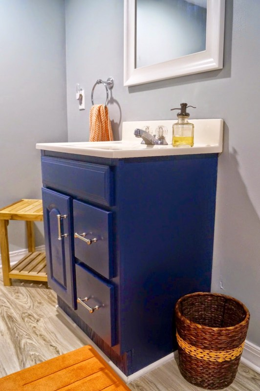 bathroom renovation with blue vanity - Old House to New Home via @Remodelaholic