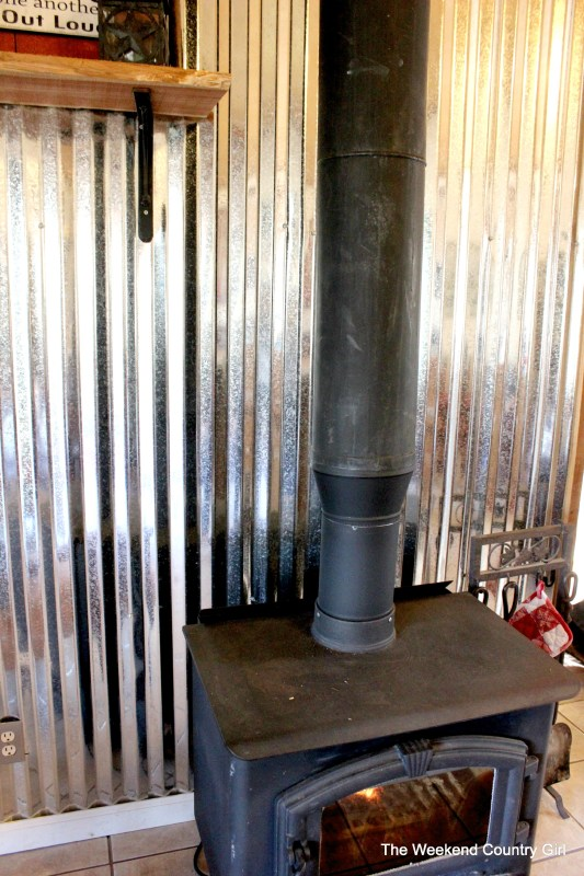 corrugated tin metal sheet wall treatment tutorial - The Weekend Country Girl featured on @Remodelaholic