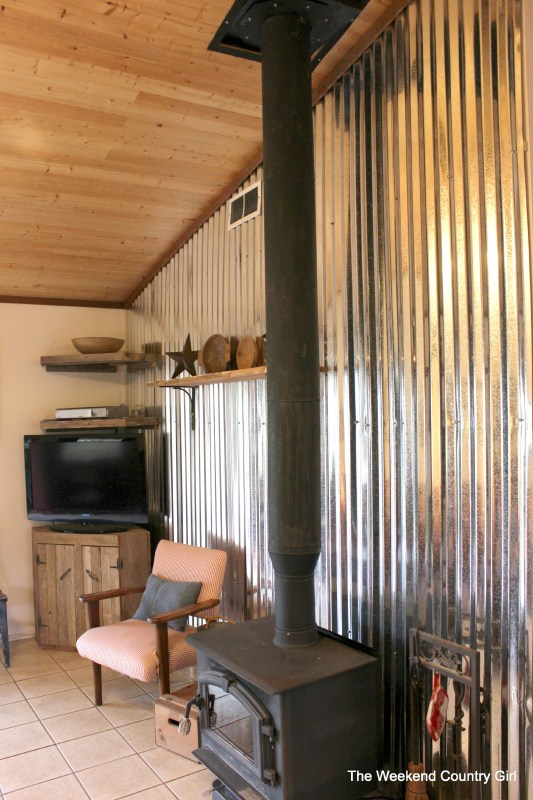 how to use corrugated tin metal sheets as an accent wall treatment - The Weekend Country Girl featured on @Remodelaholic