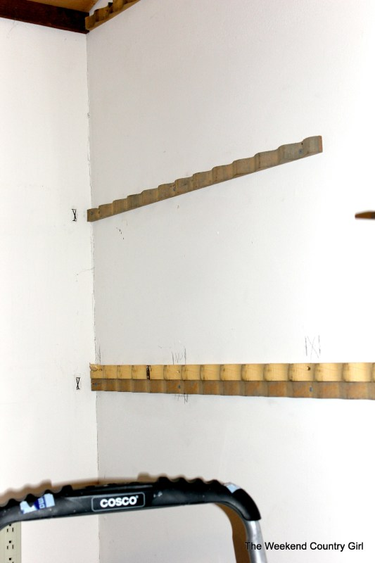 wood braces to install a corrugated tin wall treatment - The Weekend Country Girl featured on @Remodelaholic