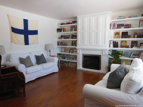 Custom Fireplace Built In with Floating Shelves by Our Home Notebook featured on Remodelaholic