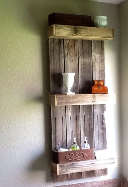Rustic shelf created from reclaimed wood by The Weekend Country Girl featured on @Remodelaholic
