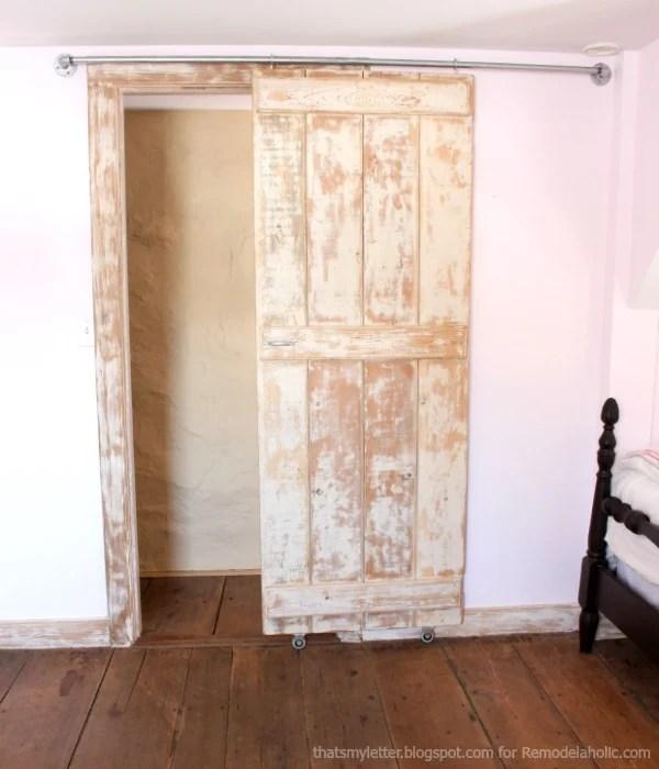 Build an easy DIY sliding barn door & Remodelaholic | DIY Sliding Barn Door + Inexpensive Hardware