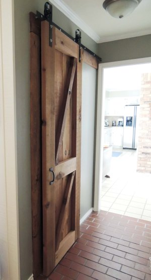 build and hang a wooden barn door on DIY rolling hardware - Do or DIY