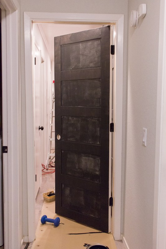 Add Style to an Old Door with Panels and Paint by Jenna Sue Design Co featured on @Remodelaholic