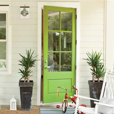Beautiful Doors - entry door with glass panes in Valspar Sassy Green via This Old House