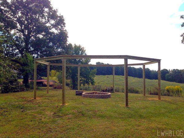 Creating a Pergola and Fire Pit by Little White House Blog featured on @Remodelaholic