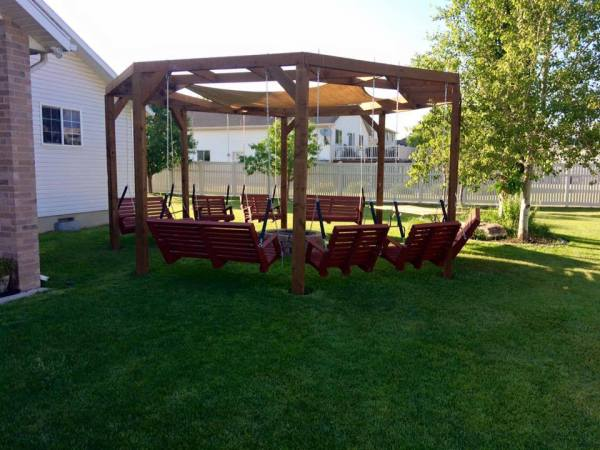 DIY round pergola with firepit and shade screen featured on @Remodelaholic