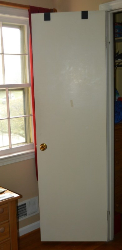Make a Flat Door Look Like a Paneled Door by The Painted Drawer featured on @Remodelaholic