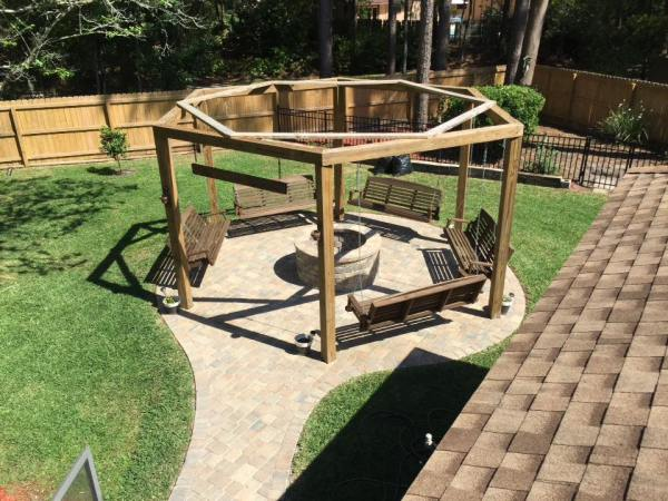 Tutorial for round pergola with swings and fire pit featured on @Remodelaholic