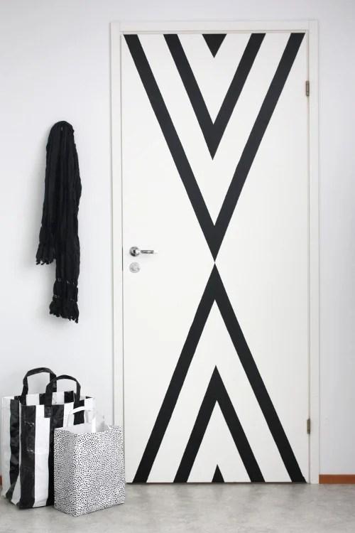 black striped contact paper door update, renter-friendly