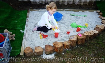 Simple log garden edging by childhood 101 featured on Remodelaholic.com