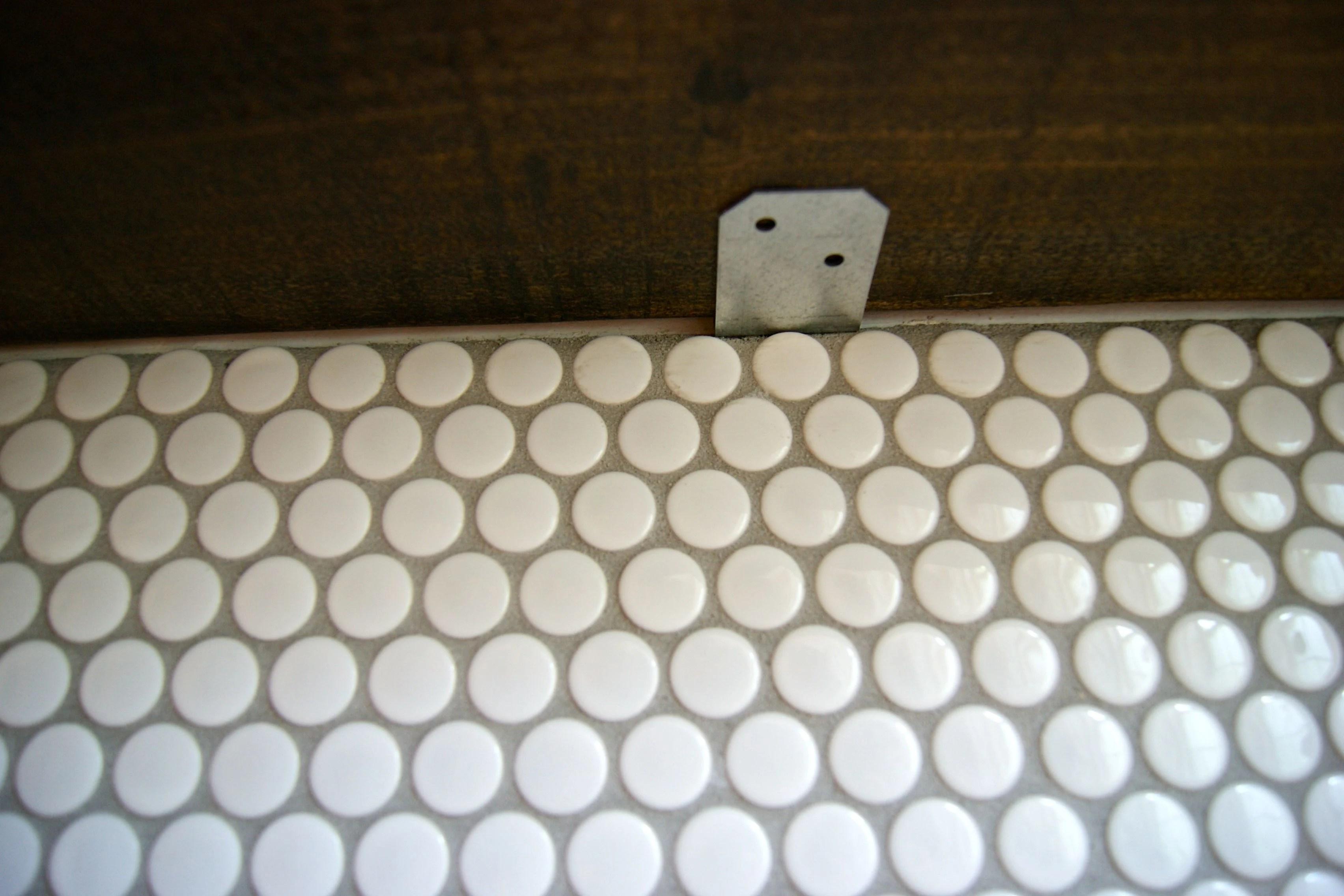 penny tile backsplash floating shelf