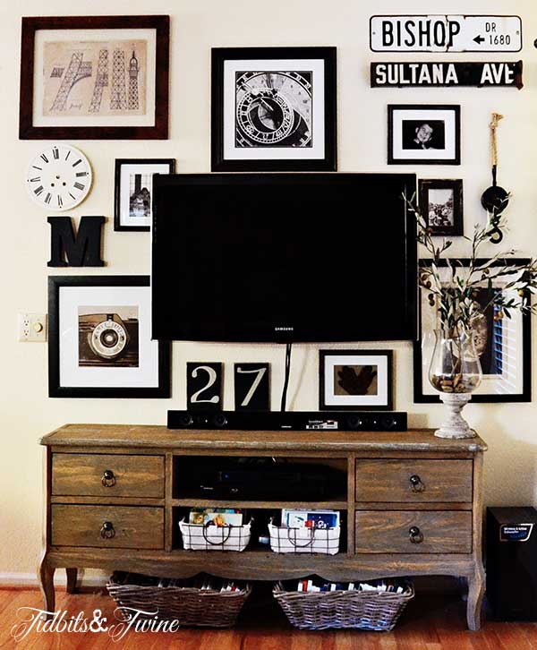 black and white vintage gallery wall around the TV (Tidbits and Twine)