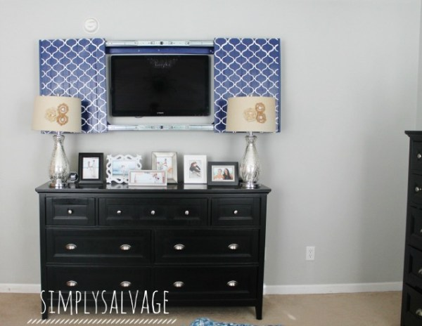 build a frame and sliding doors to hide the tv (Simply Salvage)