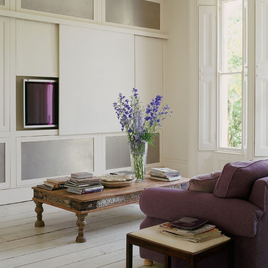 built-in cabinets with sliding panel to hide tv (House to Home)