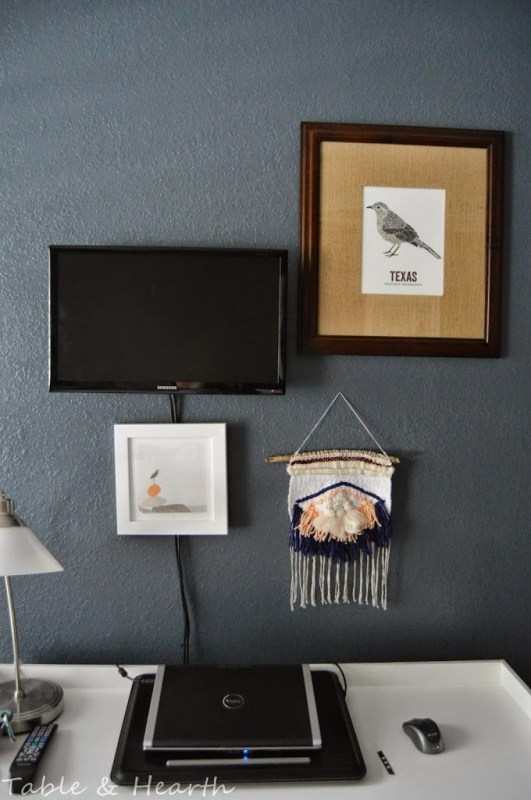 cover up TV cords with art (Table and Hearth)