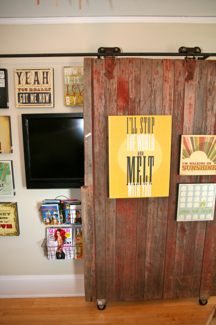 decorated sliding barn door to cover up the television (Bachmans Spring 2012 via Hirshfields)
