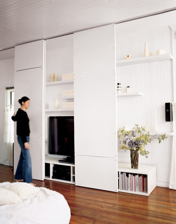 full height sliding panels hide TV and shelving (Domino)