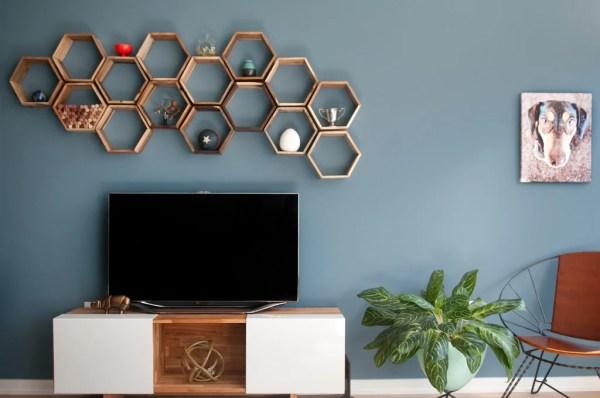 hexagonal geometric shelves above the TV (Monogram Decor)