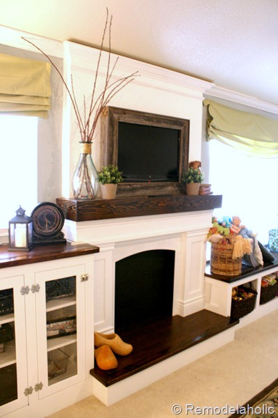 reclaimed wood framed TV with mantel to hide the cords (Remodelaholic)