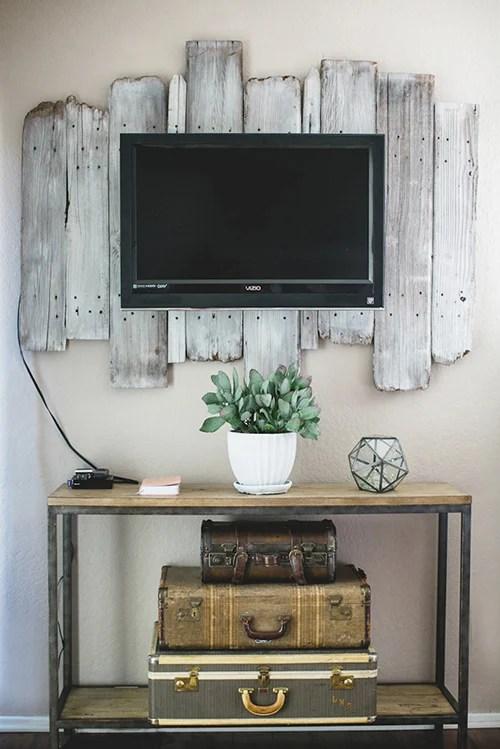 reclaimed wood whitewashed plank TV backdrop (via DesignSponge)