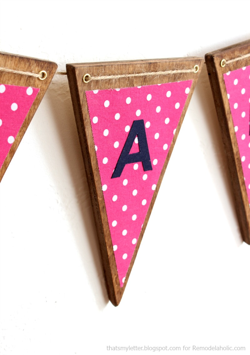 DIY wood and fabric triangle banner (bunting) -- the perfect scrapbuster!