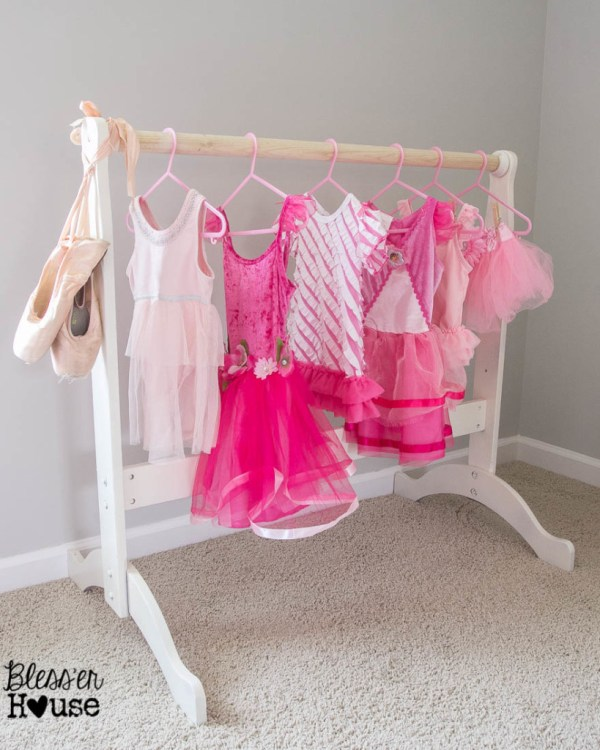 Build your little princess or super hero a place to store their outfits. Free DIY Dress Up Storage plans to build this for under $20.
