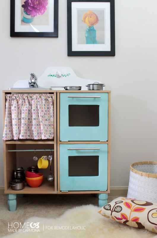 Seriously the CUTEST and easiest play kitchen ever. Easy DIY options for the sink, stovetop, double oven, and storage, that will hold up to kids actually playing.