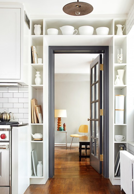 black door and trim surrounded by built in shelving (via Remodelista)