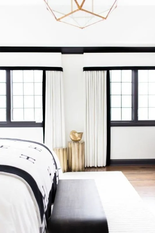 black painted trim in a black and white bedroom (via Apartment Therapy)