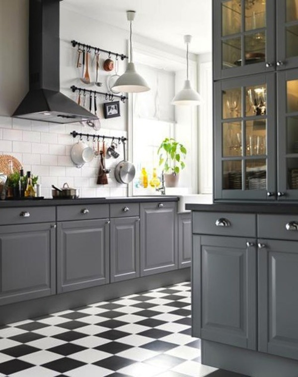 gray kitchen cabinets with black countertops (via Style Me Pretty)