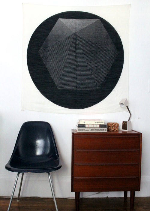 Easy DIY Wall Decor: hang an extra large scarf for inexpensive wall art (via Design Sponge)