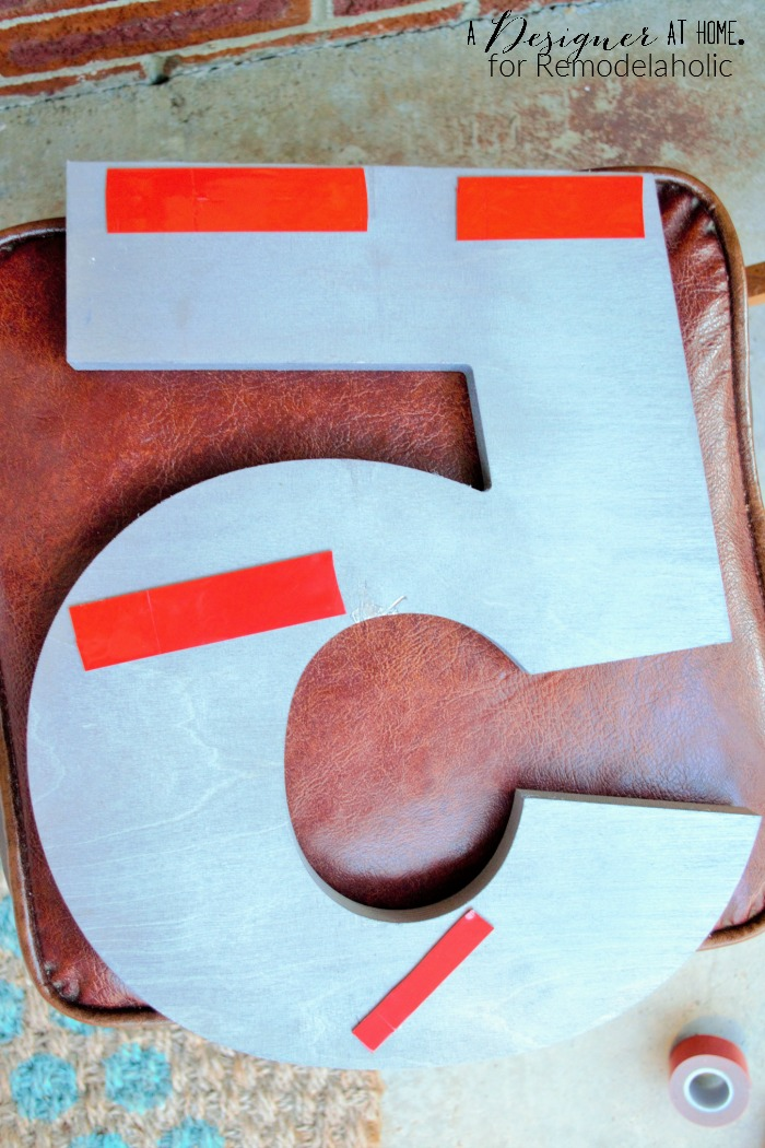 using heavy duty outdoor double sided tape to hang house numbers