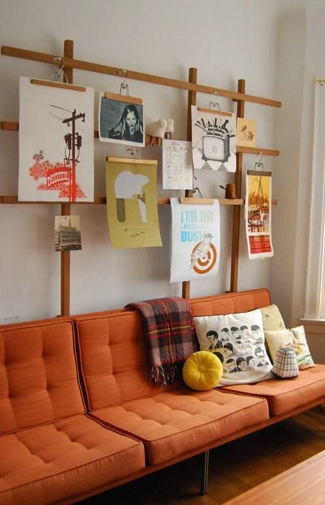wood trellis and pants hangers art and photo display (PoppyTalk)