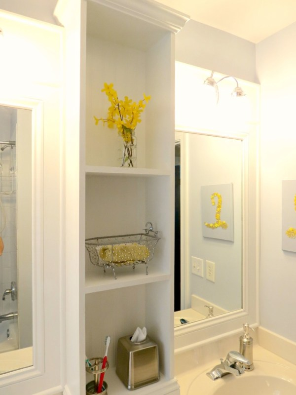 Bathroom update and makeover with shelving between two mirrors
