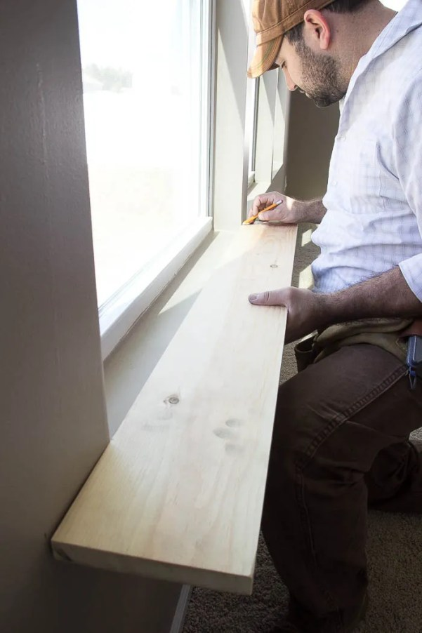 Step by step of the DIY craftsman window trim at Remodelaholic.com