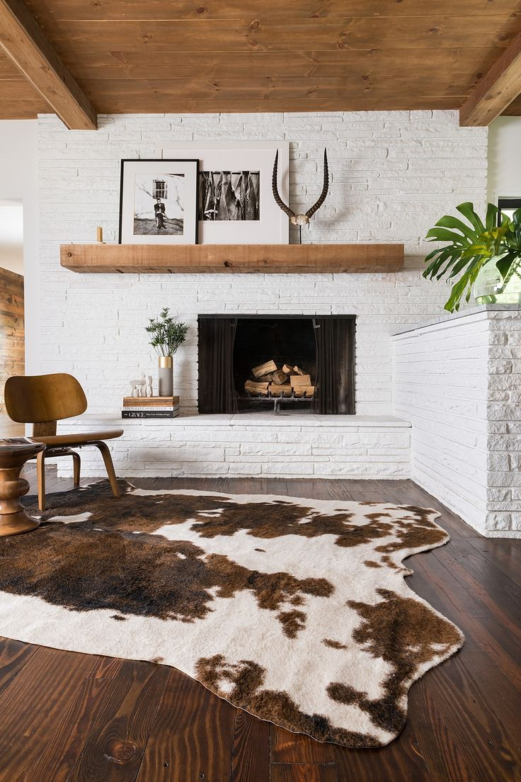 Brilliant! How to balance out an off-centered fireplace with a large mantel