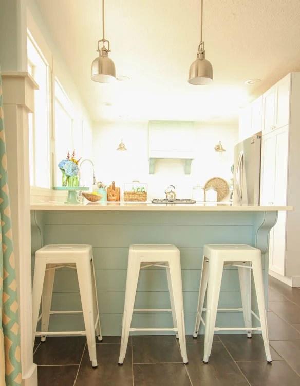 diy aqua blue planked shiplap kitchen peninsula island in a white coastal kitchen, The Happy Housie on @Remodelaholic