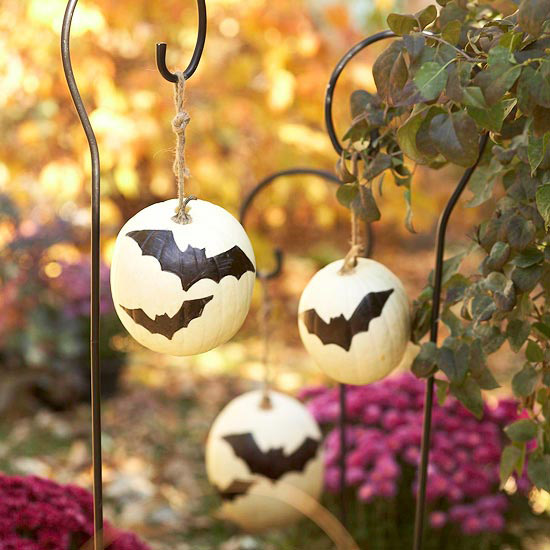 hang pumpkins from plant holders or shepherds crooks BHG