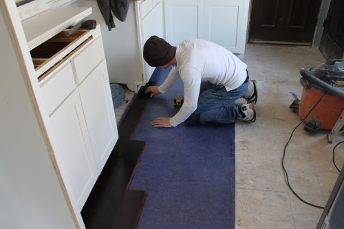 laying bamboo wood floors in a kitchen renovation, construction2style on @Remodelaholic