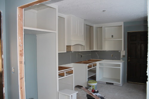 painting white cabinets and DIY range hood kitchen renovation, construction2style on @Remodelaholic