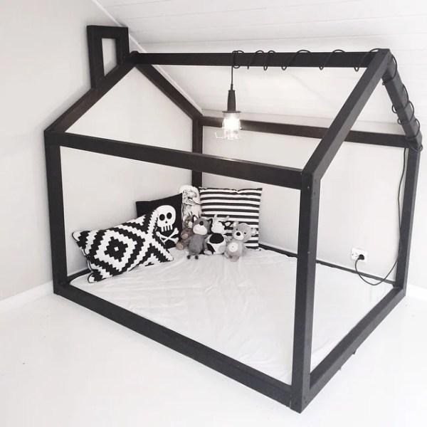 simple black and white floor bed playhouse reading corner setup via karohuseb