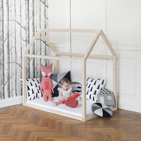 simple wood frame house floor bedframe for toddlers, with birch tree wallpaper via WoonBlog