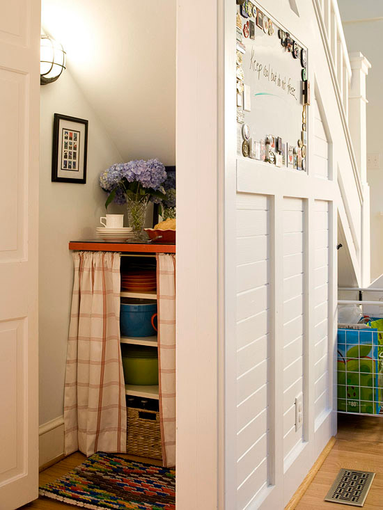 storage pantry closet under the stairs via BHG