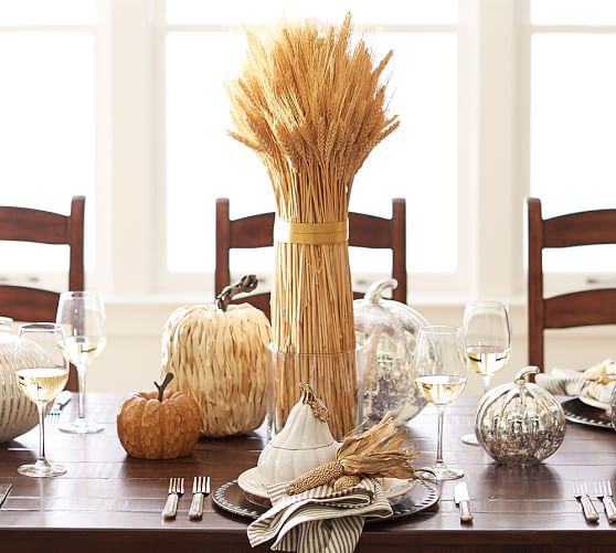 thanksgiving tablescape with mercury glass pumpkins and corn husk pumpkins and straw (via Pottery Barn)