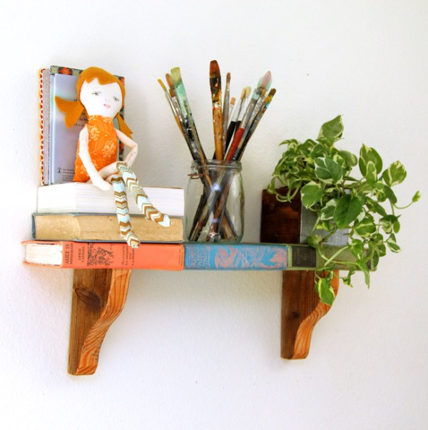 """This easy DIY """"book""""shelf is great for a book enthusiast or vintage collector! Repurpose old books into a unique DIY wall shelf, plus use our free printable book covers so you don't actually have to use rare vintage books."""