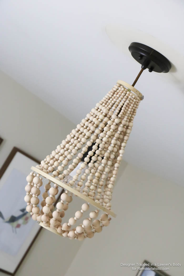 WOW! Come learn how to make your own wood bead chandelier with this awesome tutorial by Designer Trapped in a Lawyer's Body for Remodelaholic.com!