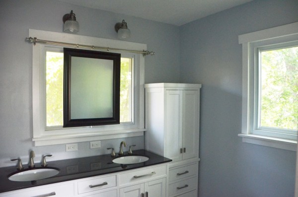 Bathroom Remodel using sliding mirror to preserve natural light