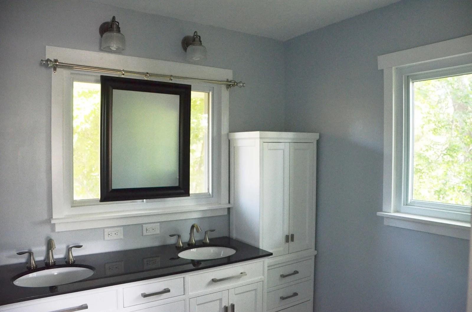 Bathroom Remodel Using Sliding Mirror To Preserve Natural Light